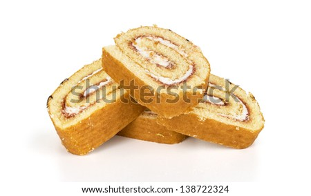 Sweet roll cake in slices, isolated on white background - stock photo