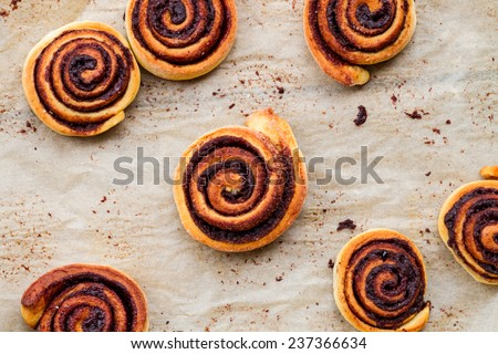 sweet rolls with cinnamon and chocolate - top view - stock photo