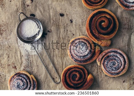 sweet rolls with cinnamon, chocolate and powdered sugar - top view - stock photo