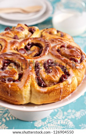 Sweet rolls with dried fruits and dripping glaze - stock photo