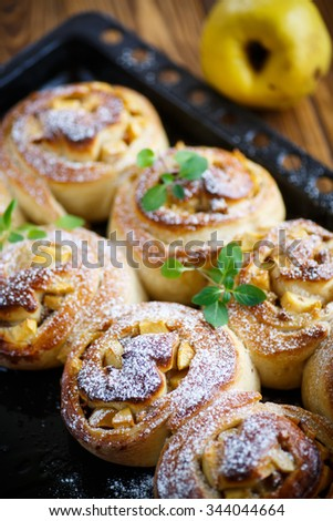 sweet rolls with quince in the table - stock photo