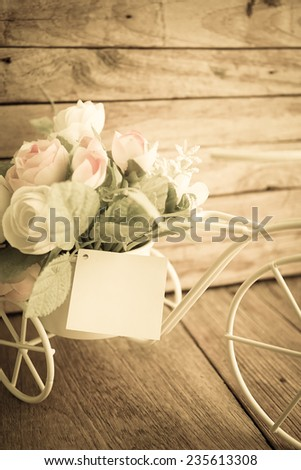 sweet roses soft color on bicycle, vintage style background