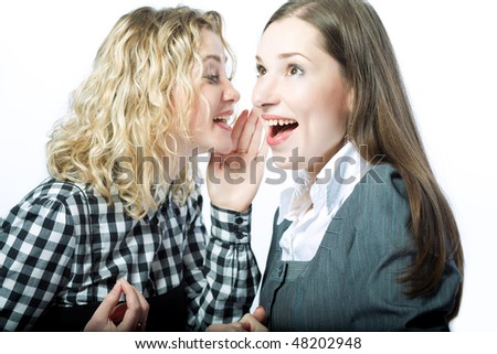 sweet rumors between two girlfriends standing isolated over white background