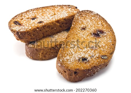 sweet rusks with raisins sprinkled with sugar on a white background - stock photo