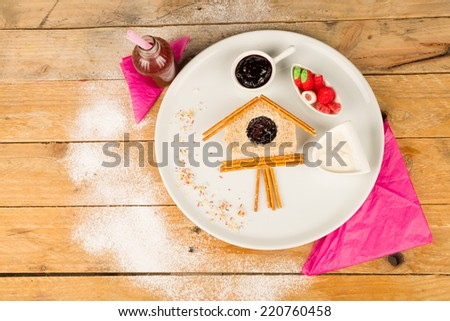 Sweet sandwich in the shape of a cuckoo clock - stock photo