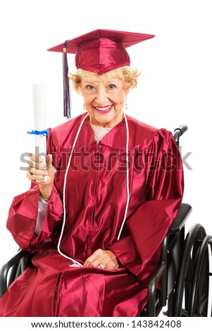 Sweet senior lady in wheelchair, proudly holding up her diploma.  White background - stock photo