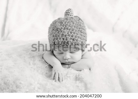 sweet sleeping baby with hat  (black and white) - stock photo
