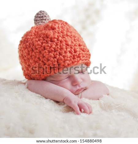 sweet sleeping baby with pumpkin hat - stock photo