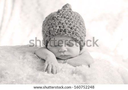 sweet sleeping baby with pumpkin hat ( black and white ) - stock photo