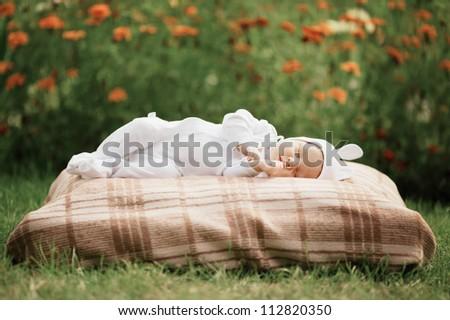sweet sleeping baby with rabbit costume - stock photo
