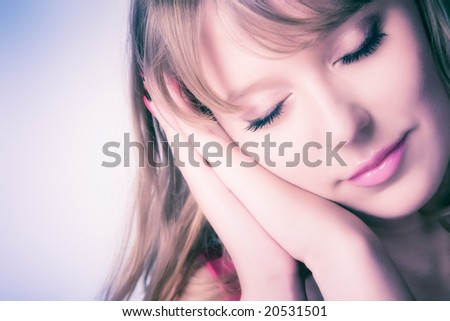 Sweet sleeping woman. Soft pink tint. - stock photo