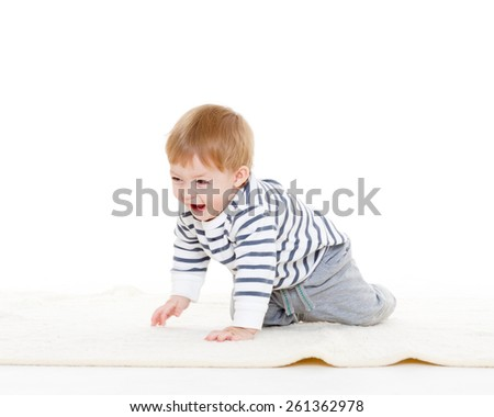Sweet small baby crawling on carpet on a white background. - stock photo