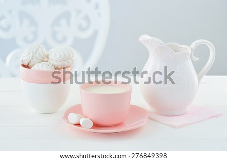Sweet still life with candy colors porcelain crockery, milk and marshmallows - stock photo