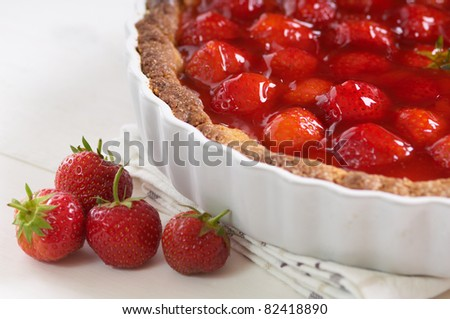 sweet strawberry pie on a white table - stock photo