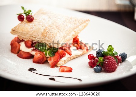 Sweet strudel with peach, strawberries and cottage cheese - stock photo