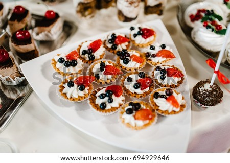 A plate of cakes and muffins with cream with berries. Table with & Sweet Table Plate Cakes Muffins Cream Stock Photo u0026 Image (Royalty ...