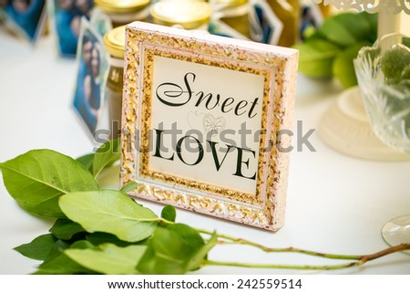 Sweet table. Frame with the message - stock photo