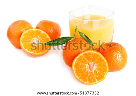 Sweet tangerines juice in glass on white background