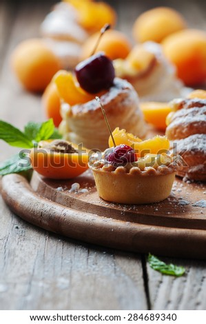 Sweet tarts with cherry and apricot, selective focus - stock photo