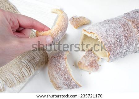 Sweet tasteful traditional slovak and czech roasted delicacy - vanilla trdelnik - stock photo