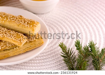 sweet tasty cake on white plate with green eve - stock photo