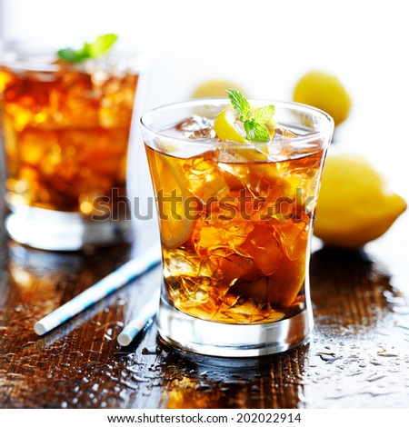 sweet tea with lemon slices and mint - stock photo
