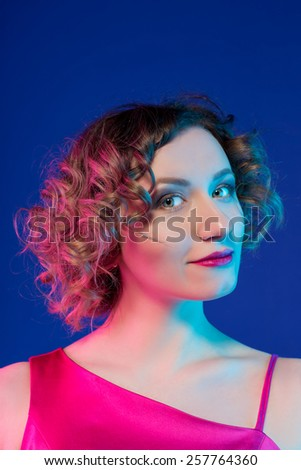 sweet tender girl with curly styling on blue - stock photo