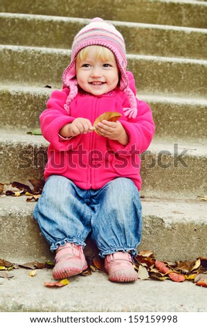 sweet toddler girl in fall time - stock photo