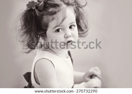 sweet toddler girl with hair style in dress - stock photo