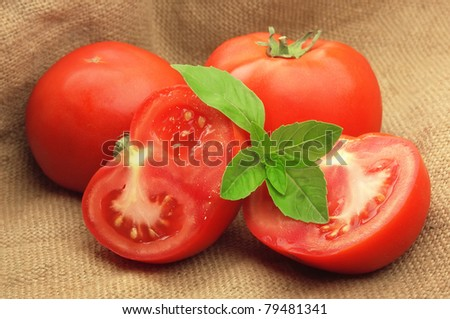 sweet tomatoes with basil in linen bag
