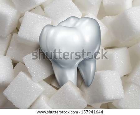 Sweet tooth dental health care concept as a single molar in a pile of sugar cubes as a health and diet symbol for craving sweetened foods that are bad for your health and diabetes risk.diabetes risk - stock photo