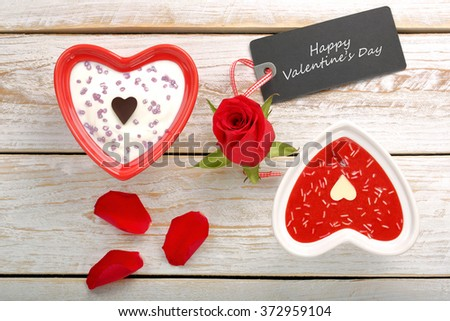 Sweet treat for Valentines Day with card for text on white wooden background