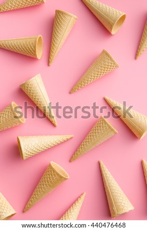 Sweet wafer cones on pink background.