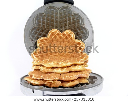 sweet waffles into the iron waffles maker - stock photo