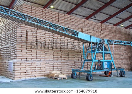 Sweet Wall - Sugar Bags and Conveyor in a Warehouse - stock photo