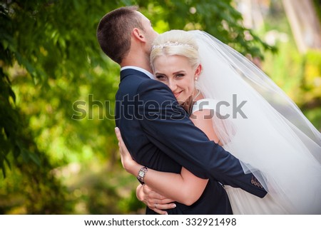 sweet wedding bride and groom in an embrace - stock photo