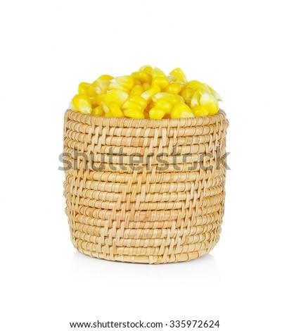 Sweet whole kernel corn in basket on white background - stock photo