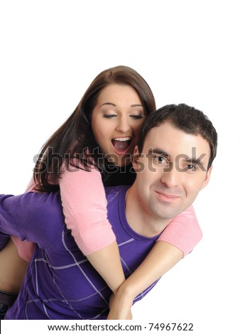 sweet young couple in love having fun. isolated