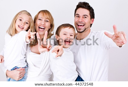 sweet young family having fun  in their home - stock photo