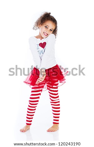 Sweet young kid with a red skirt and an I love Santa shirt - stock photo