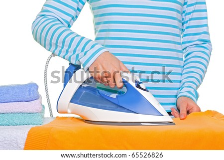 Sweet young lady ironing her clothes - stock photo