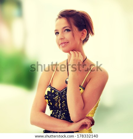 Sweet young woman (teenage girl) in yellow/black dress