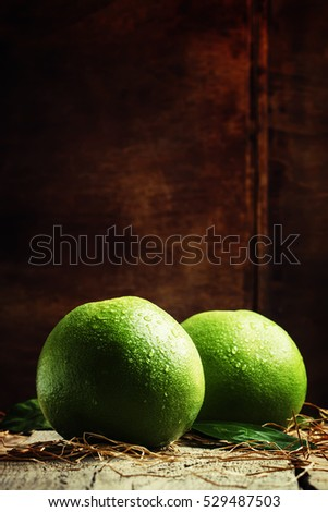 Sweetie, green grapefruit or pomelo, vintage wooden background selective focus