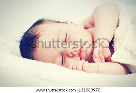 sweetly sleeping baby - stock photo