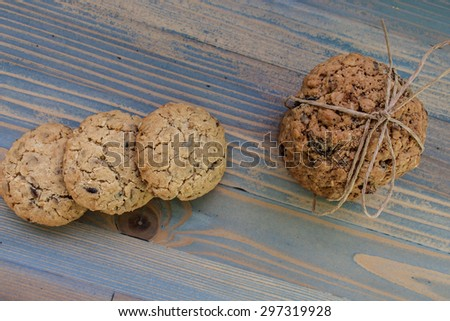 Sweetmeats. Two types of oatmeal cookies with sunflower seeds and raisins. Some related cord with bow, a second overlapping ends. View from above. Perfect for a day trip, party, meeting over coffee. - stock photo