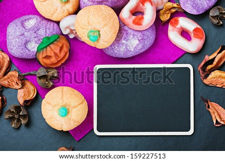 sweets and candies for Halloween and blackboard