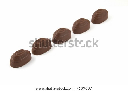 Sweets chocolate with a stuffing, on a white background