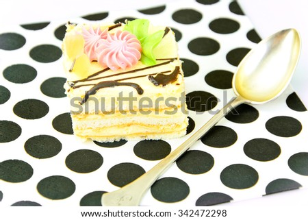 Sweets: Cream Cakes on Plate. Studio Photo
