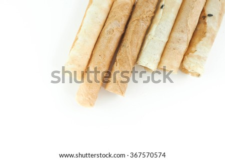 sweets Tong Muan ,Thai dessert, Roll wafer isolated on white background in Thailand (a type of rolled wafer, a traditional dessert in Thailand)