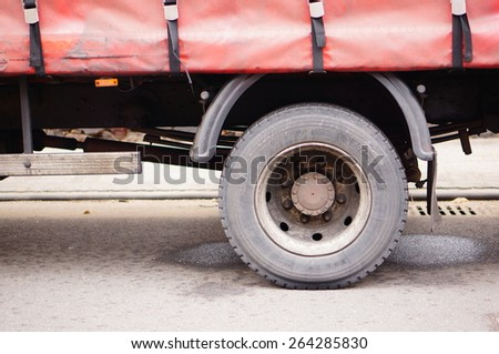 SWIECIE, POLAND - FEBRUARY 28, 2015: Wheel of a truck trailer